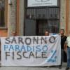"""Blitz di Attac! in consiglio: """"Saronno paradiso fiscale. Mancano 800 mila euro di Imu"""""""
